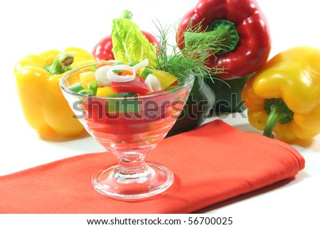 colorful bell pepper salad with dill in a small glass bowl