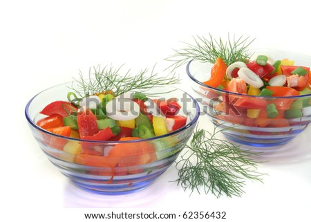 colorful bell pepper salad with dill in small glass bowl
