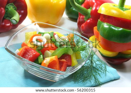colorful bell pepper salad with dill in small glass bowls