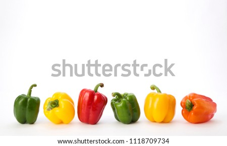Colorful bell pepper vegetable isolated on white background ,minimal top view with copy space. Linear arrangement.