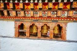 Colorful Bhutanese Prayer Wheels in a Bhutanese Temple