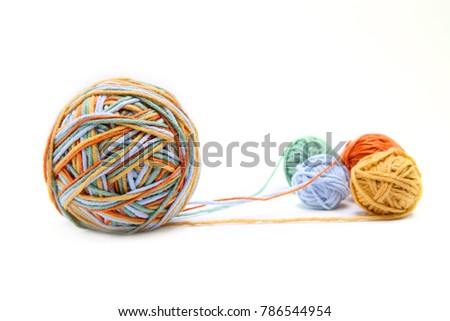 Colorful big thread ball from four color thread. Cotton thread balls isolated on white background. Different color (orange, yellow, green, blue) thread mix. Stock foto ©