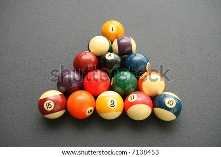 Colorful Billiard Balls on a Pool Table with gray felt