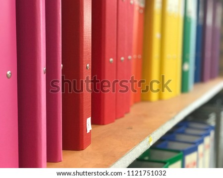 Colorful binders on a shelf in the store. Back to school background
