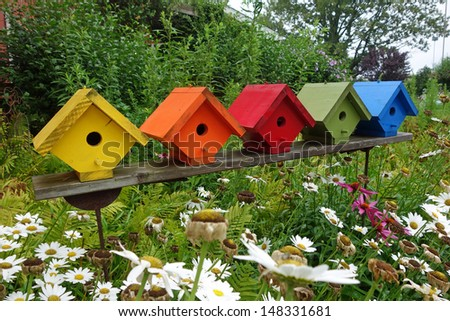 Colorful birdhouses in the garden