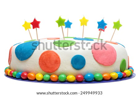Colorful birthday cake with decorations, isolated on white background