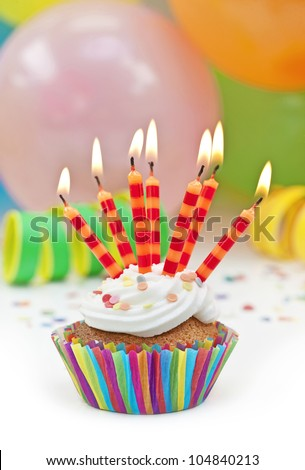 Colorful birthday candles and balloons