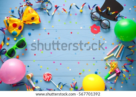 Colorful birthday frame with party items on blue background. Happy birthday concept #567701392