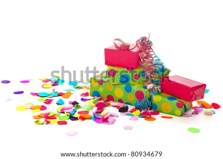 Colorful birthday presents with paper confetti isolated on white background