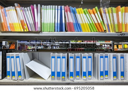 Colorful blank office folders stacking on rack for business and education concept #695205058