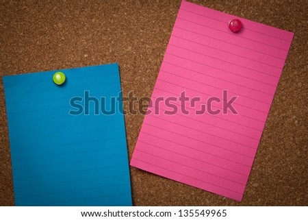 Colorful blanked notes pinned on a corckboard