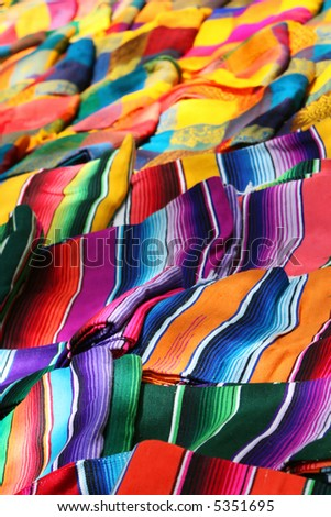 Colorful blankets offered for sale at a stand in the yucatan region of mexico