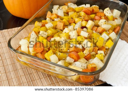 Colorful blend of roasted potatoes, yams, carrots, yellow beets, parsnips and rutabaga