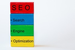 colorful blocks with the words Search, Engine, Optimization and on top a red block with the letters SEO. The background is isolated in white