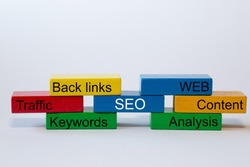 colorful blocks with the words: SEO, WEB. Content, Analyses, Keywords, Traffic, Back links, are isolated against a white background with space for text