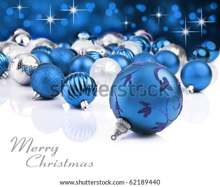 Colorful blue christmas decoration baubles on white with space for text
