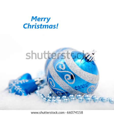 Colorful blue christmas decoration baubles on white with space for text. (shallow DoF)
