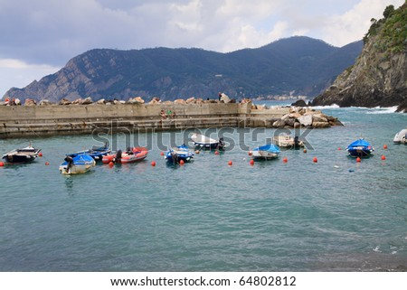 Colorful boats in the harbor at Vernazza Cinque Terre Italy