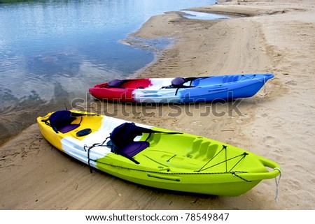 colorful boats on beach along river