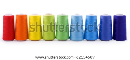 colorful bobbins isolated on white background with clipping path - stock photo