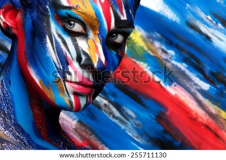 Colorful body art on the body of the girl. Beautiful paint on the body. - Shutterstock ID 255711130