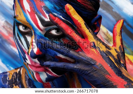 Colorful body painting on the body of the girl. Suitable for advertising paints.