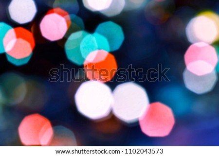 Colorful bokeh abstract background. Festive Christmas elegant abstract background with bokeh lights and stars