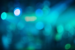 Colorful bokeh background with defocused blurred multicolored light