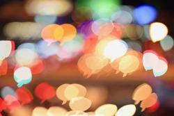 Colorful bokeh speech bubble shape ,city  at night