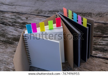 Colorful bookmarks for documents with notebook , closeup of colour tabs for bookmarks, Different colorful sticky (Multi-coloured stickers) colorful paper tag label. Case study concept.