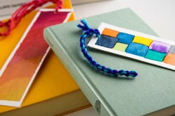 colorful bookmarks on a closed yellow andf green book. education. reading.