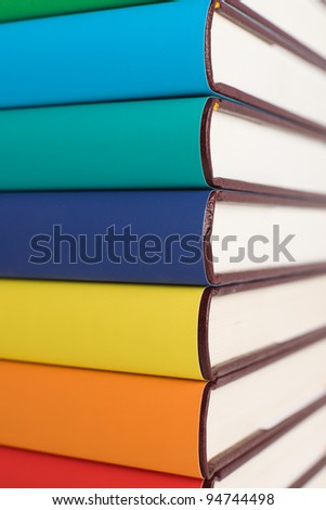Colorful books on pile.
