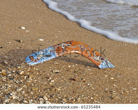 Colorful boomerang on a sandy beach
