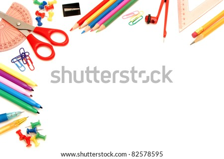 Colorful border of an assortment of school or office supplies on a white background