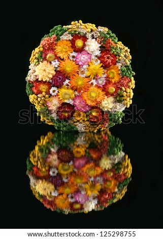 Colorful bouquet of dried flowers on a black background