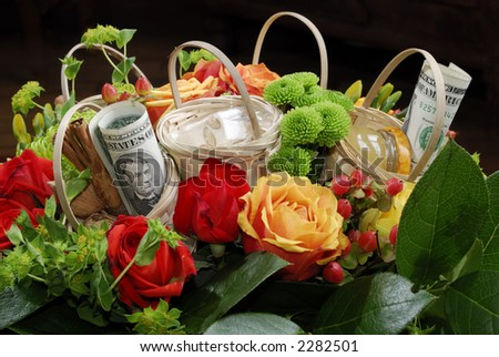 Colorful bouquet with baskets and dollar bill
