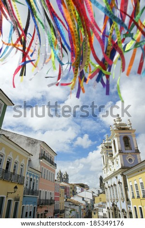 Colorful Brazilian wish ribbons waving in the bright sky above colonial architecture of Pelourinho Salvador Bahia Brazil