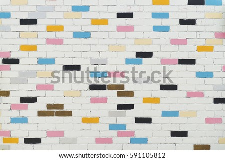 Colorful brick wall pattern, painted bricks as urban design texture.