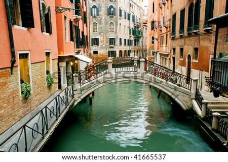 Colorful bridge across canal in Venice, Italy