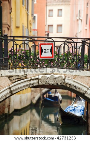 Colorful bridge across the canal in Venice, Italy