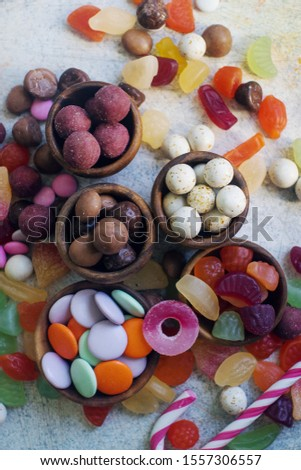 Colorful bright assorted sweets and candy for kids party on white table, assortment of many candies  #1557306557