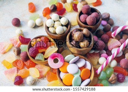 Colorful bright assorted sweets and candy for kids party on white table, assortment of many candies  #1557429188