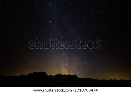 Colorful bright milky way in the sky at night stock photo