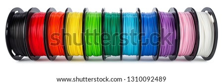 colorful bright wide panorama row of spool 3d printer pla abs filament plastic material isolated on white background