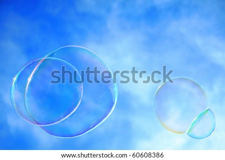 Colorful bubbles against a blue sky