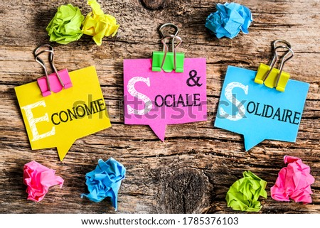 Colorful bubbles shaped paper with the French acronym word 'Economie Sociale et Solidaire' means Social and Solidarity Economy  Photo stock ©
