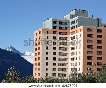 Colorful  building in Whittier Alaska  (the Begich Building, former army barracks)  on a sunny summer day
