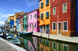 Colorful buildings in Burano island sunny street, Venise, Italy