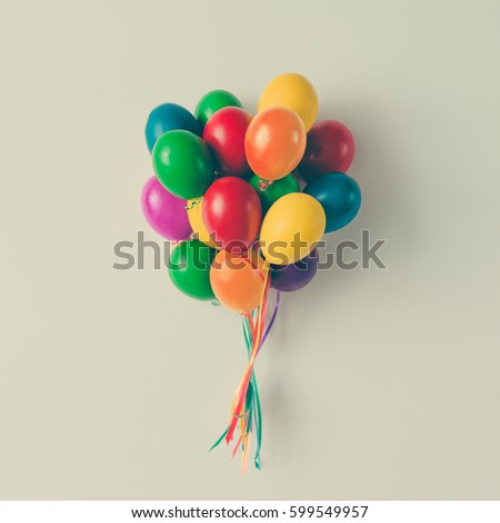 Colorful bunch of Easter egg balloons on bright white background. Minimal creative concept. Flat lay.