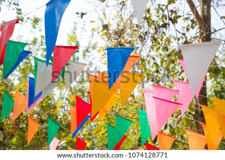 Colorful bunting in outdoor summer festival #1074128771